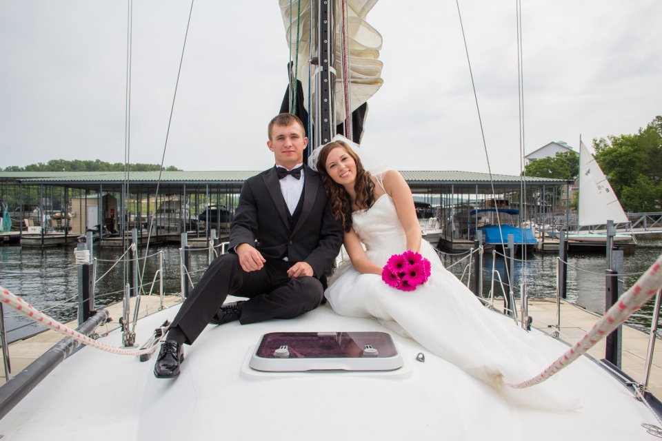 bride and groom on boat bow