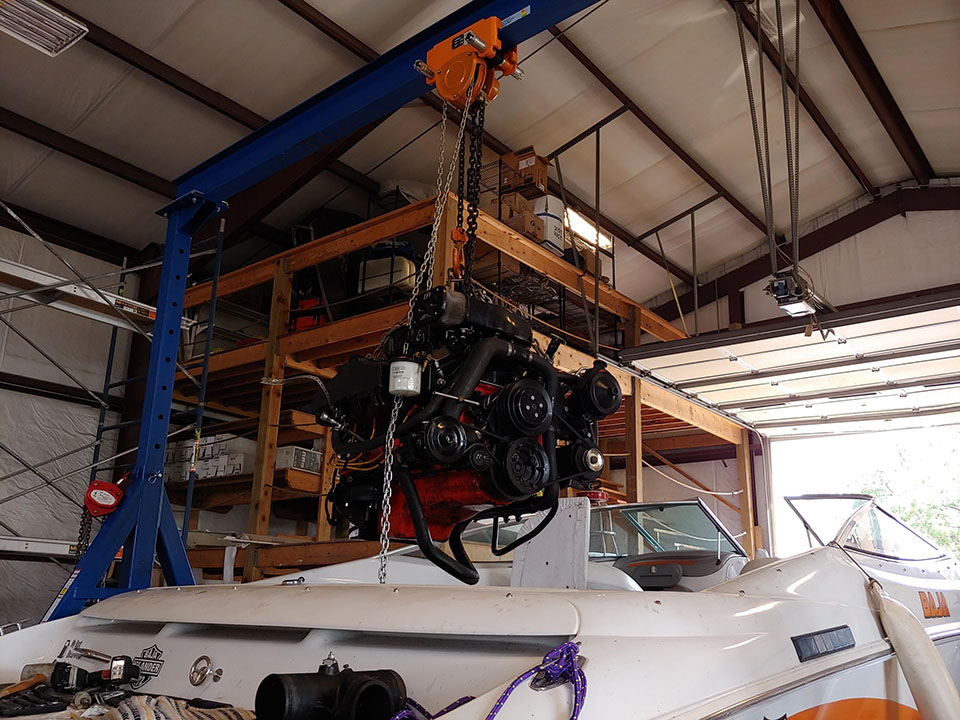 removing an engine from a boat for service