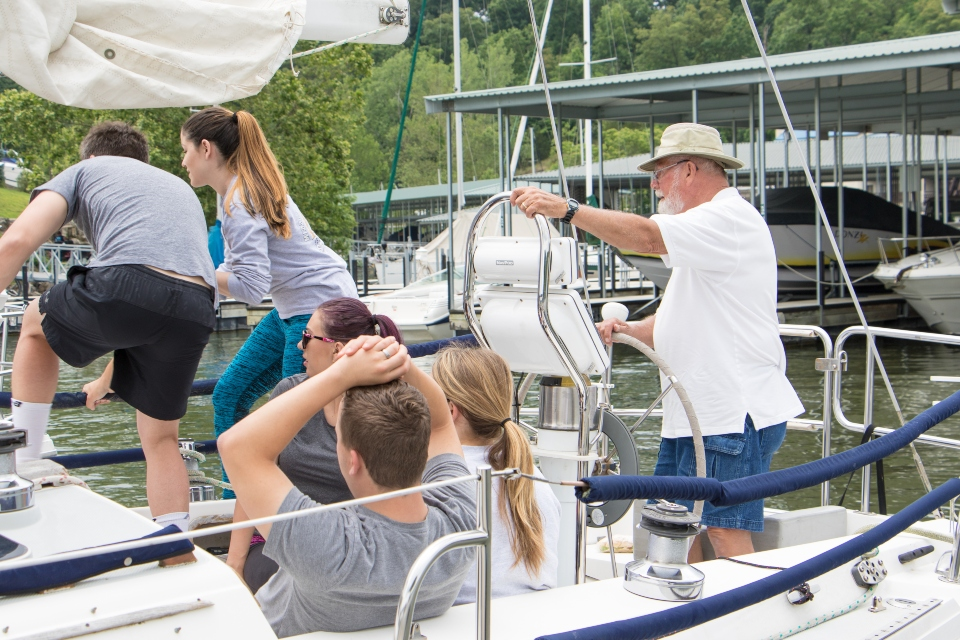 sailing instructor showing students sailing techniques